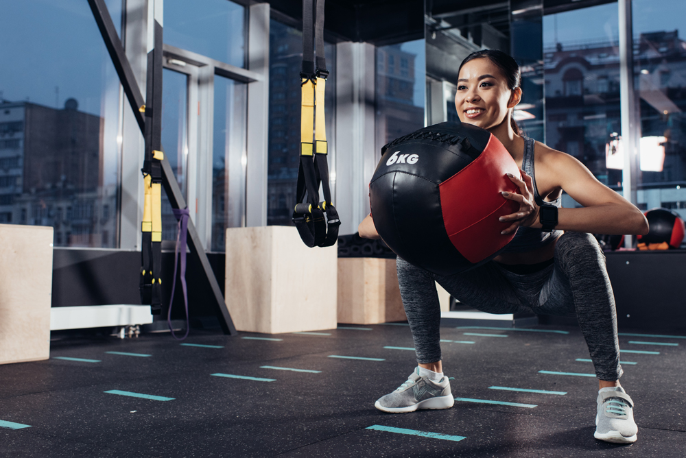 Asian Woman Working Out In a Gym